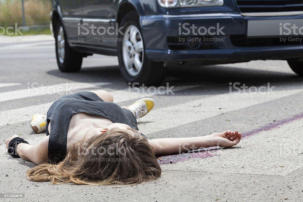 Dead woman lying on a street stock photo