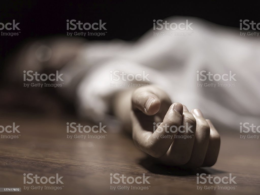Dead woman's body with focus on hand stock photo