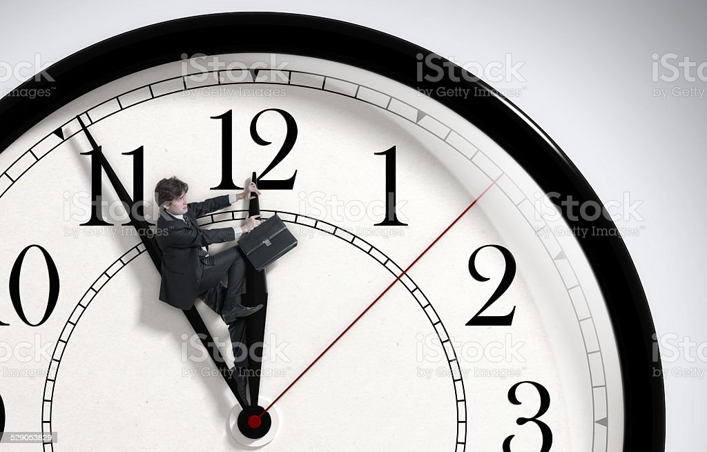 Deadline. Businessman trying to stop time. Time Management. stock photo