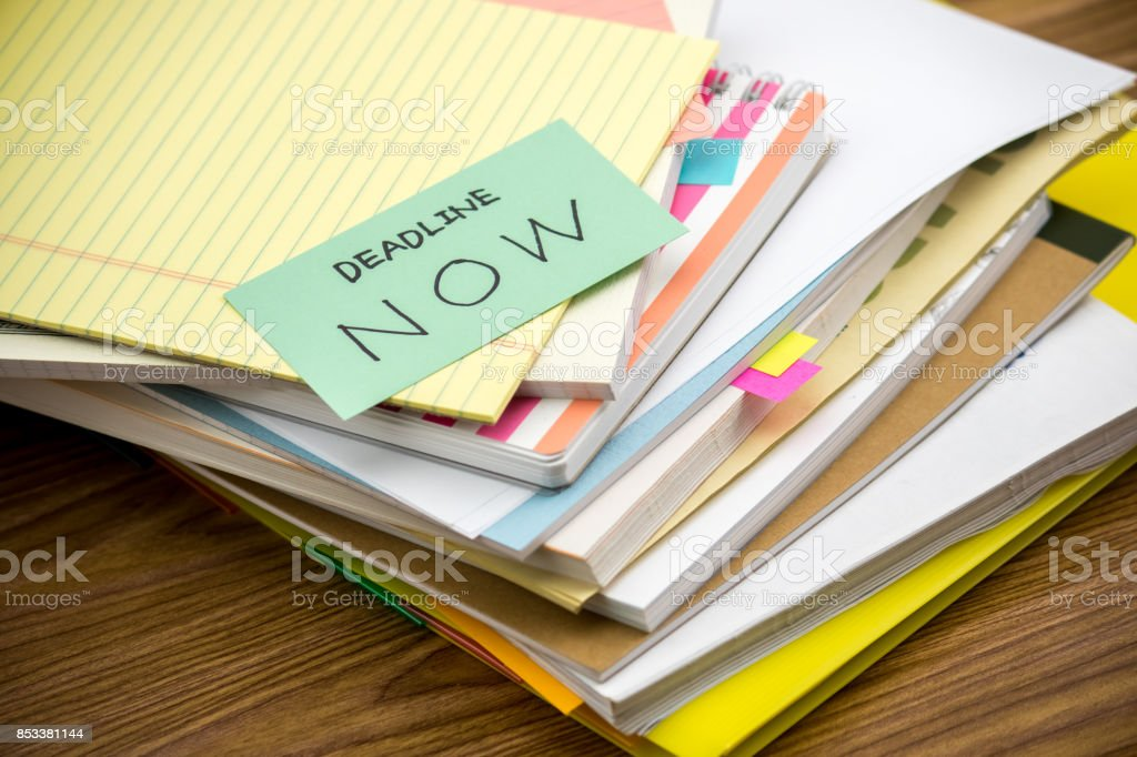 Deadline Now; The Pile of Business Documents on the Desk stock photo