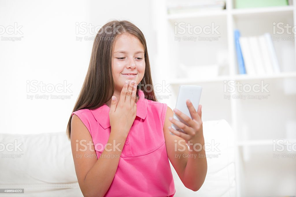Deaf girl talking using sign language on the smartphone's cam stock photo