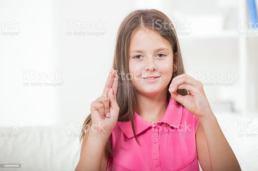 Deaf girl using sign language stock photo