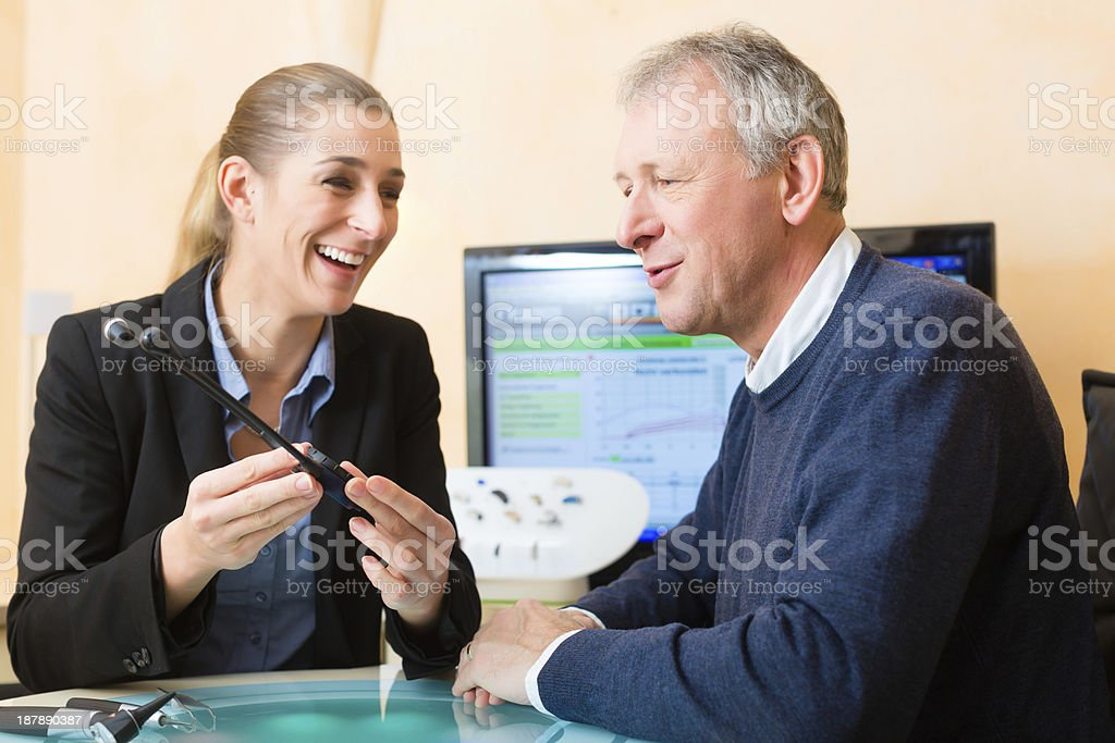 Deaf man makes a hearing test stock photo