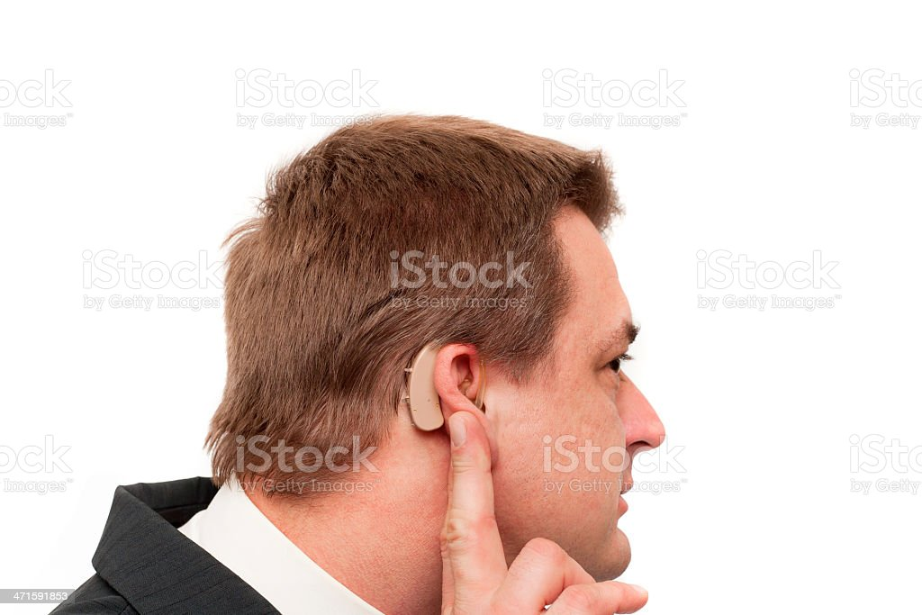 Deaf man's hearing aid royalty-free stock photo
