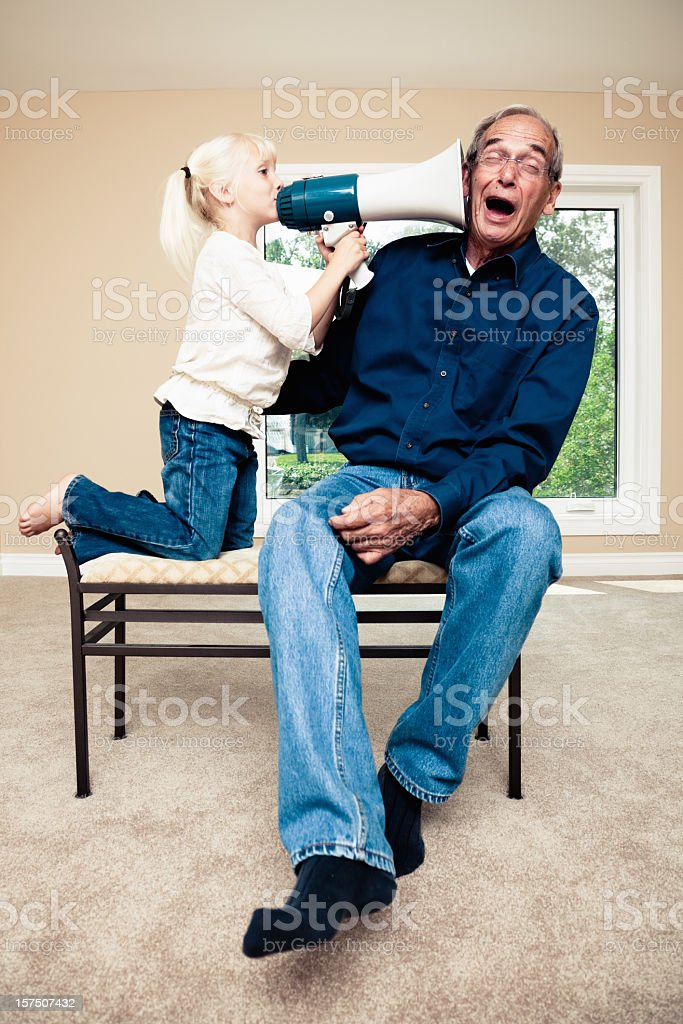 Deaf Senior with Granddaughter stock photo
