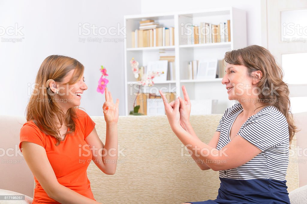 Deaf woman learning sign language stock photo