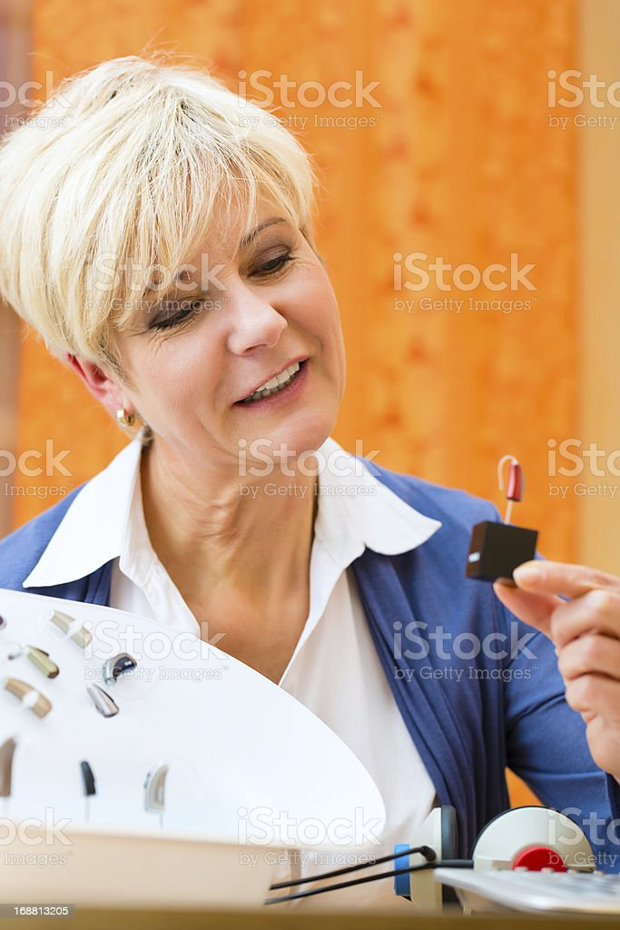 Deaf woman makes a hearing test royalty-free stock photo