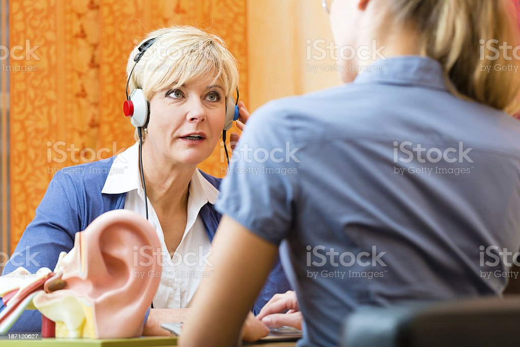 Deaf woman takes a hearing test stock photo