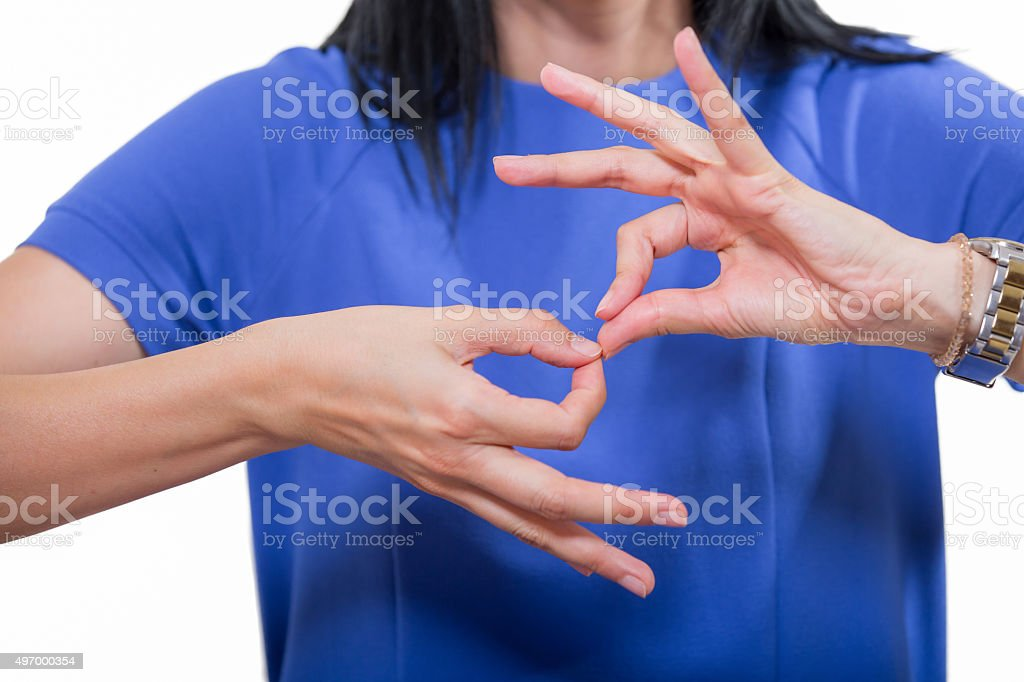 Deaf woman using sign language stock photo