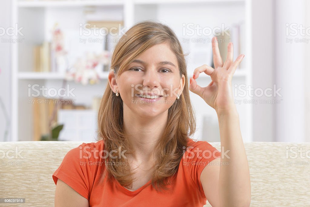 Deaf woman using sign language stock photo