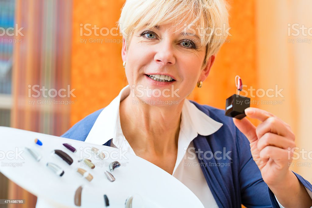 Deaf woman with hearing aid royalty-free stock photo
