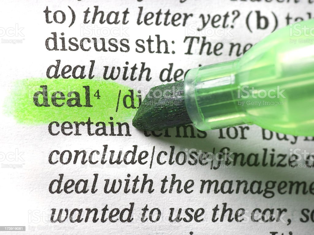 deal definition highligted in dictionary royalty-free stock photo