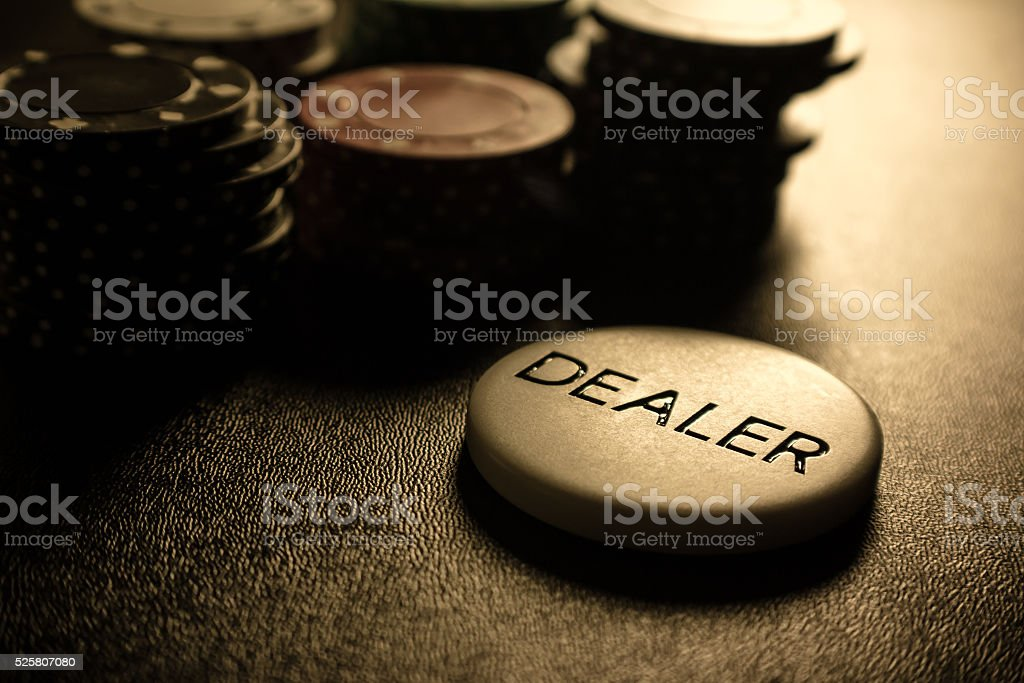 Dealer Button with Poker Chips stock photo