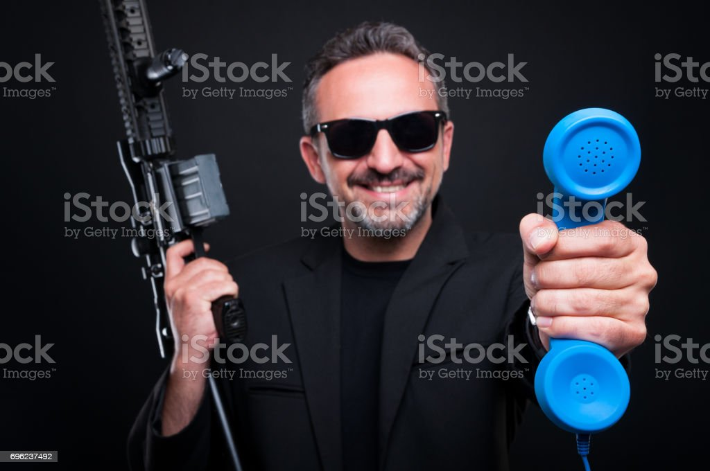 Dealer mafia gangster holding deathly weapon stock photo
