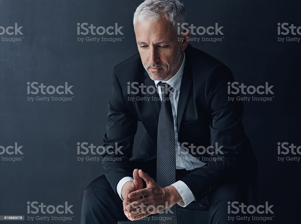 Dealing with hard decisions during hard times stock photo