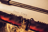 'Dear love' typed using an old typewriter