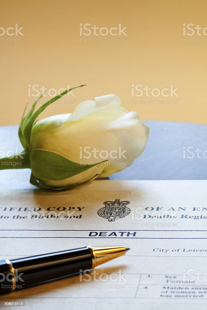 Death Certificate and Rose stock photo