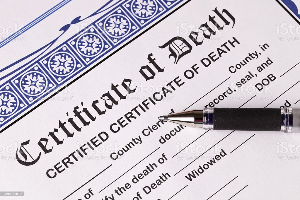 Death Certificate with pen. Close-up of top of certificate stock photo