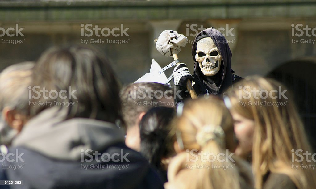 Death in a crowd stock photo