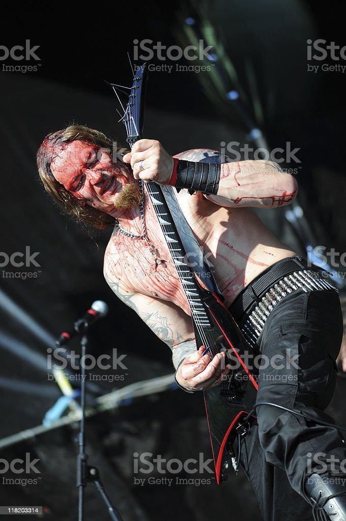 death metal guitarist on open air concert stock photo