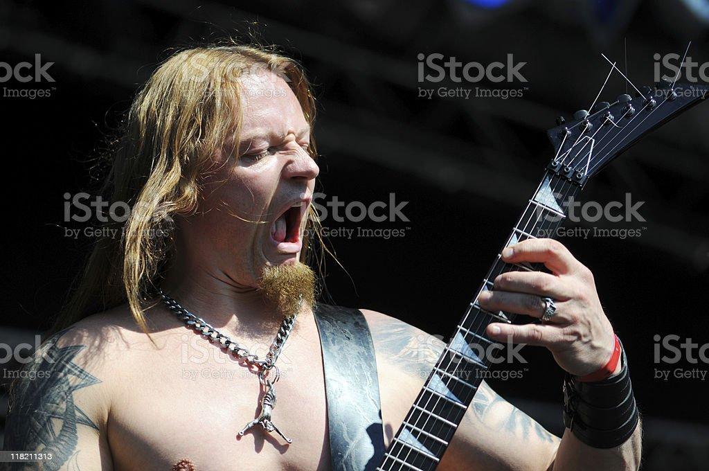 death metal guitarist playing stock photo