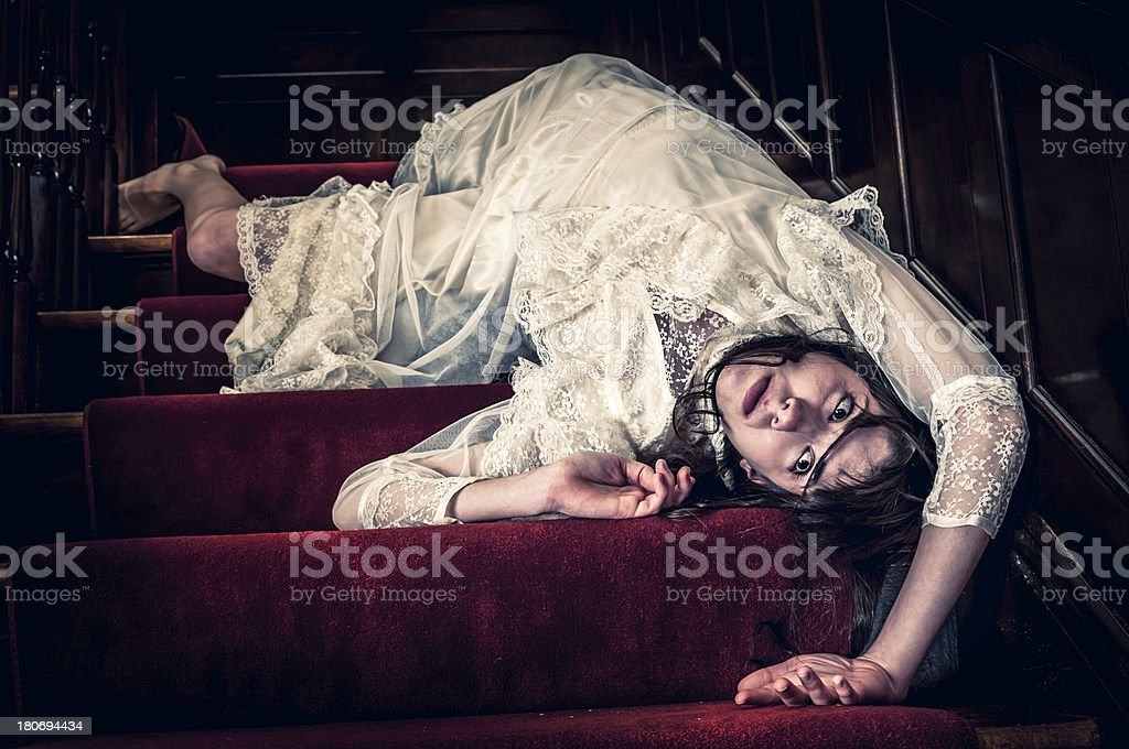 Death of young woman on the stairs - I royalty-free stock photo