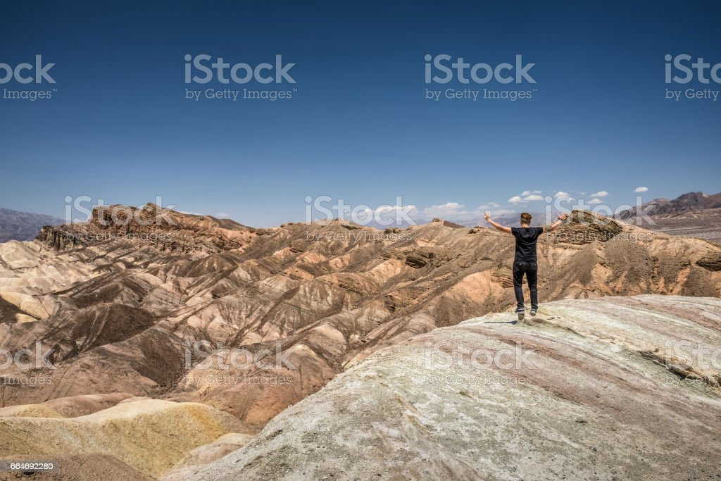 Death Valley and a happy hiker stock photo