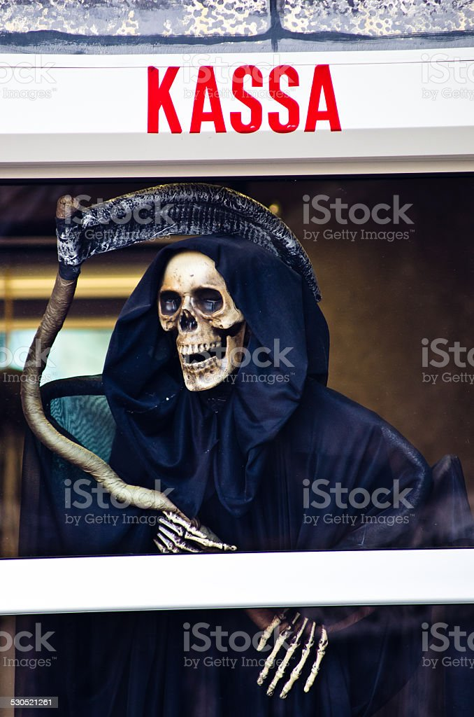Death with scythe waiting for you on a payday stock photo