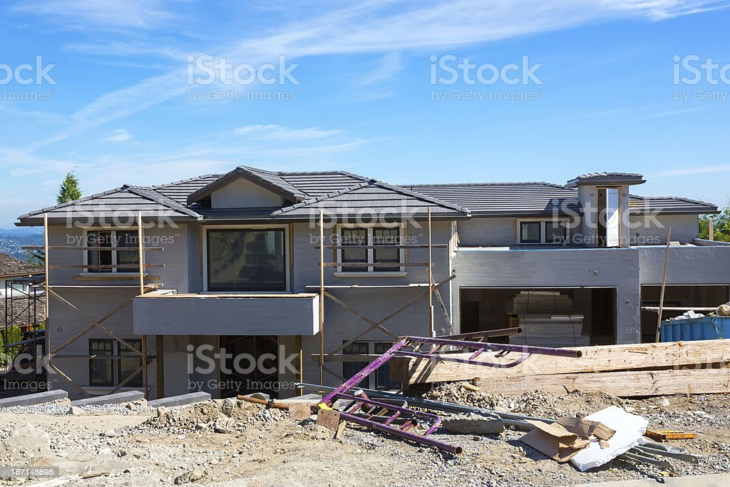 Debris by a modern home in the process of being built. royalty-free stock photo