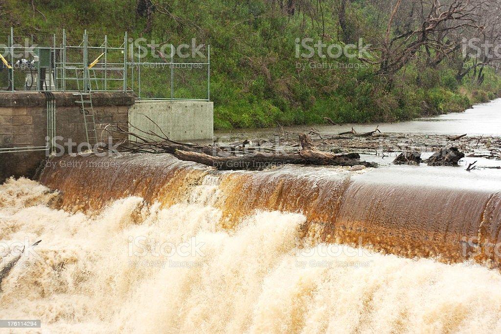 Debris on Overflowing Dam stock photo