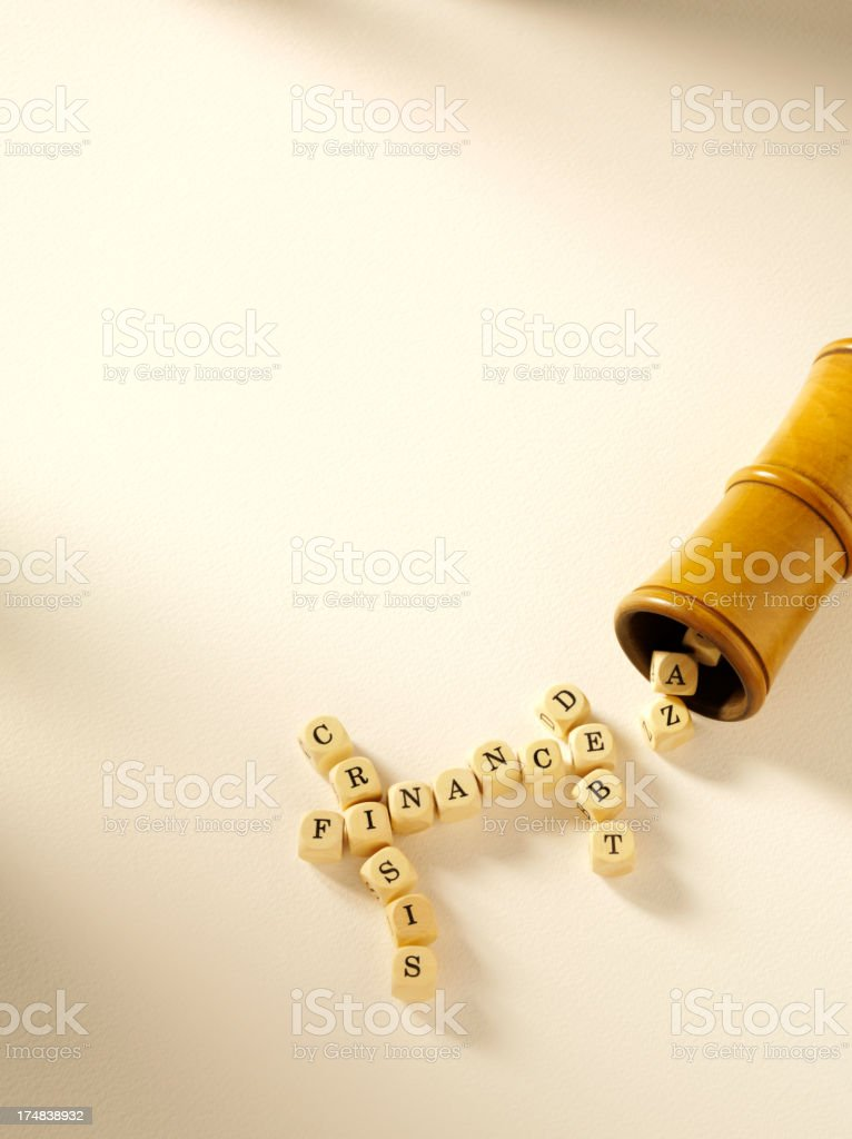 Debt and Finance Crisis on Dice in a Crossword royalty-free stock photo