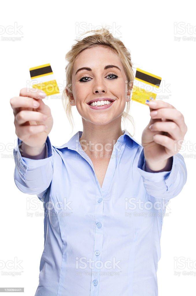 Debt free woman holding a credit card cut in two pieces royalty-free stock photo