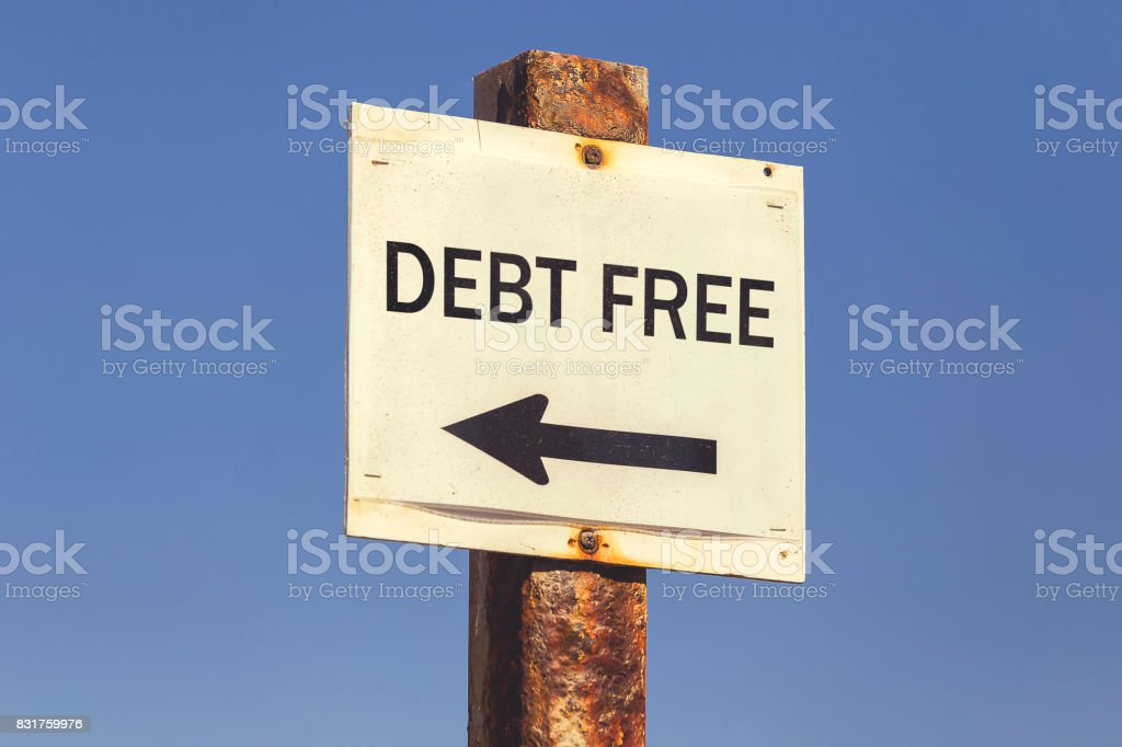 Debt free word and arrow signpost 2 stock photo