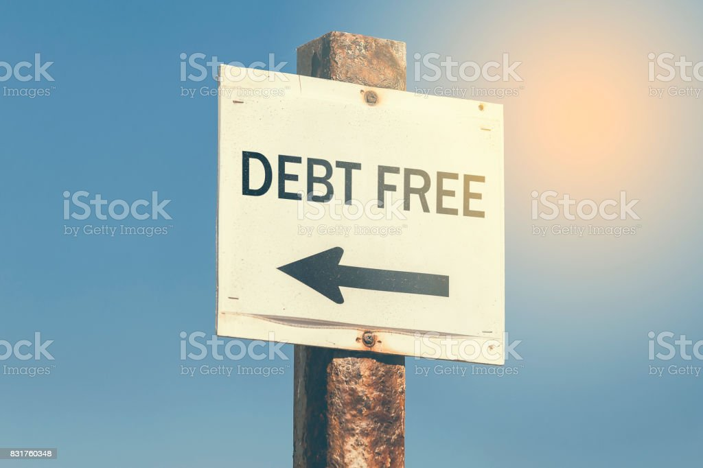 Debt free word and arrow signpost 3 stock photo