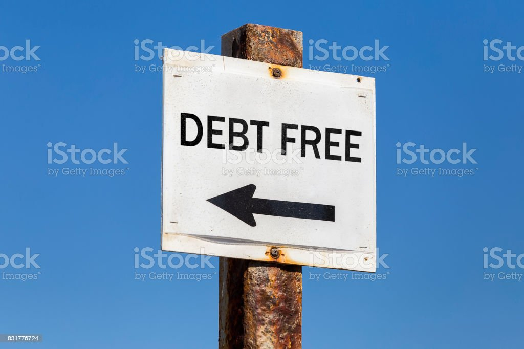 Debt free word and arrow signpost stock photo