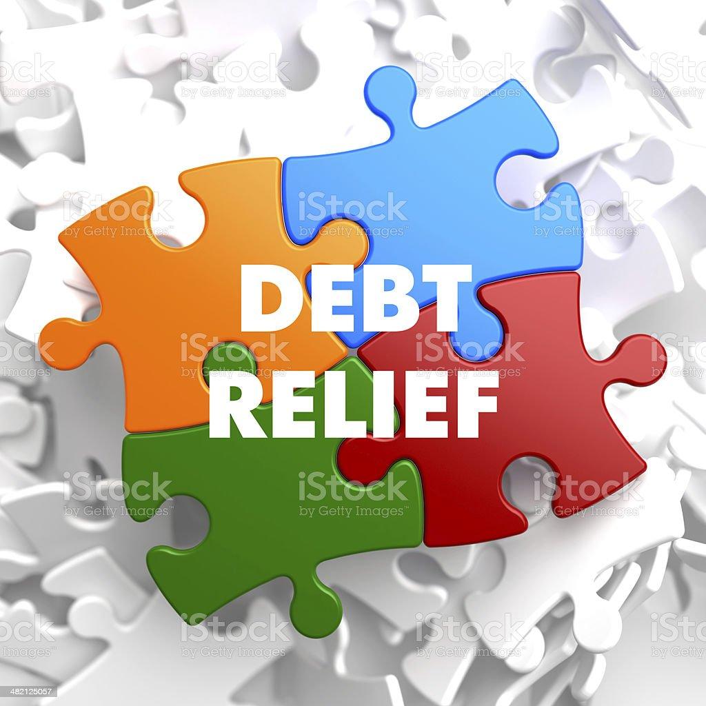 Debt Relief on Multicolor Puzzle. stock photo
