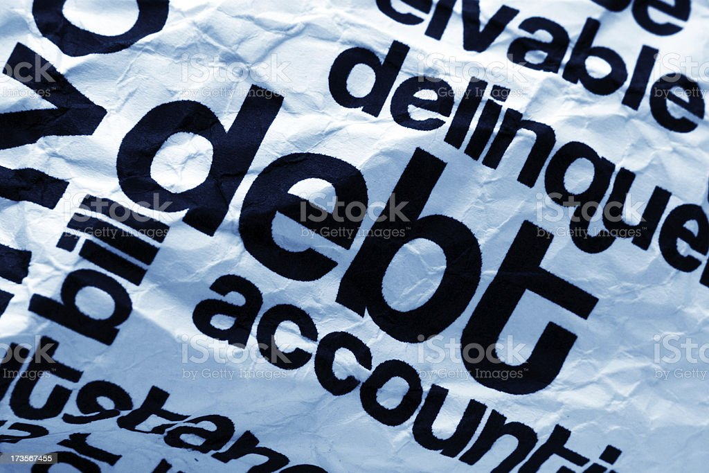 Debt text on paper stock photo