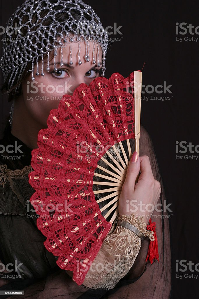 Decadanse with a red fan stock photo