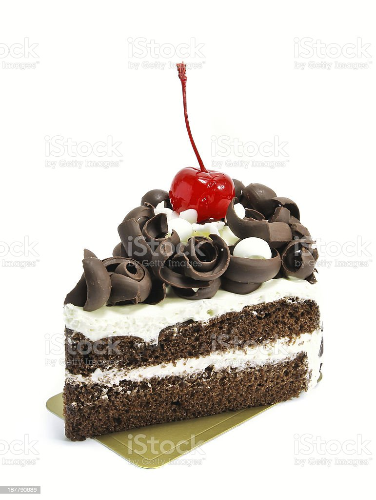 A decadent chocolate cake with a glazede cherry on top  stock photo