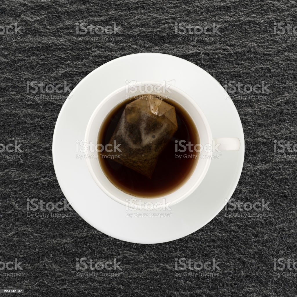 Decaffeinated black tea with tea bag in a cup stock photo