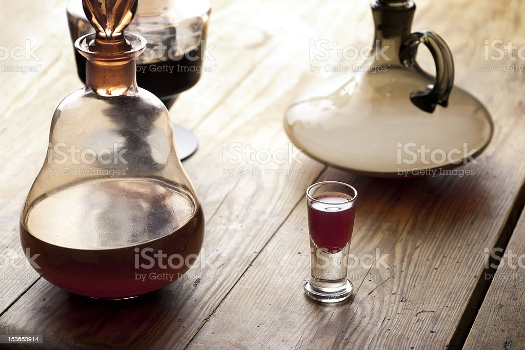 Decanter with glass of liqueur. royalty-free stock photo