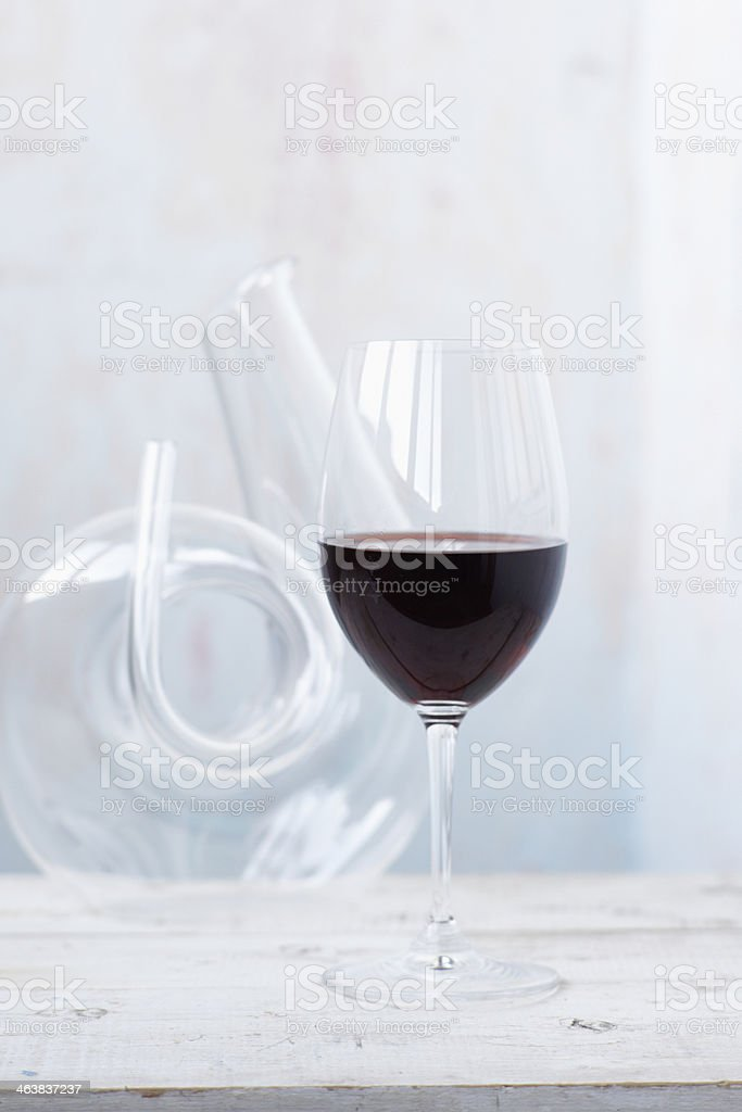 decanter with red wine and glass on a rustic background royalty-free stock photo