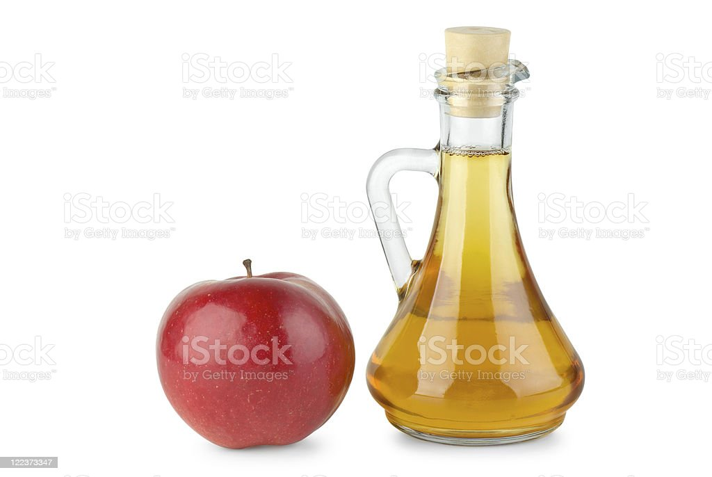 Decanter with vinegar and red apple stock photo