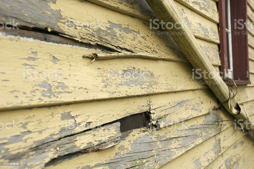 Decayed Siding on Urban Dwelling royalty-free stock photo