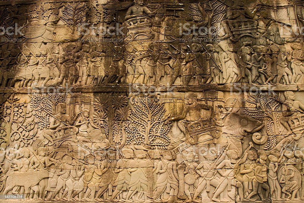 Decaying bas-relief in Angkor Wat royalty-free stock photo