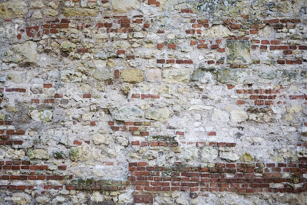 Decaying brick wall in Paris, France royalty-free stock photo