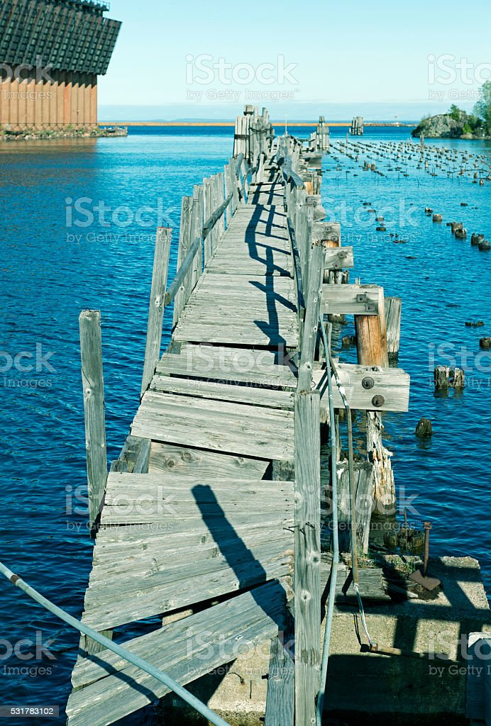 Decaying dock in Lake Superior at Marquette MI stock photo