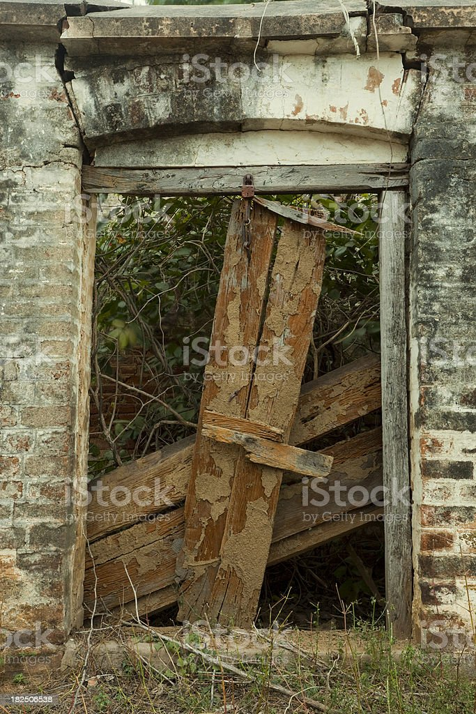 Decaying door in an old, abandoned house royalty-free stock photo