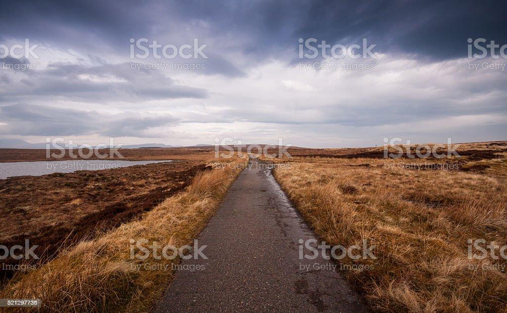 Decaying road on empty moor stock photo