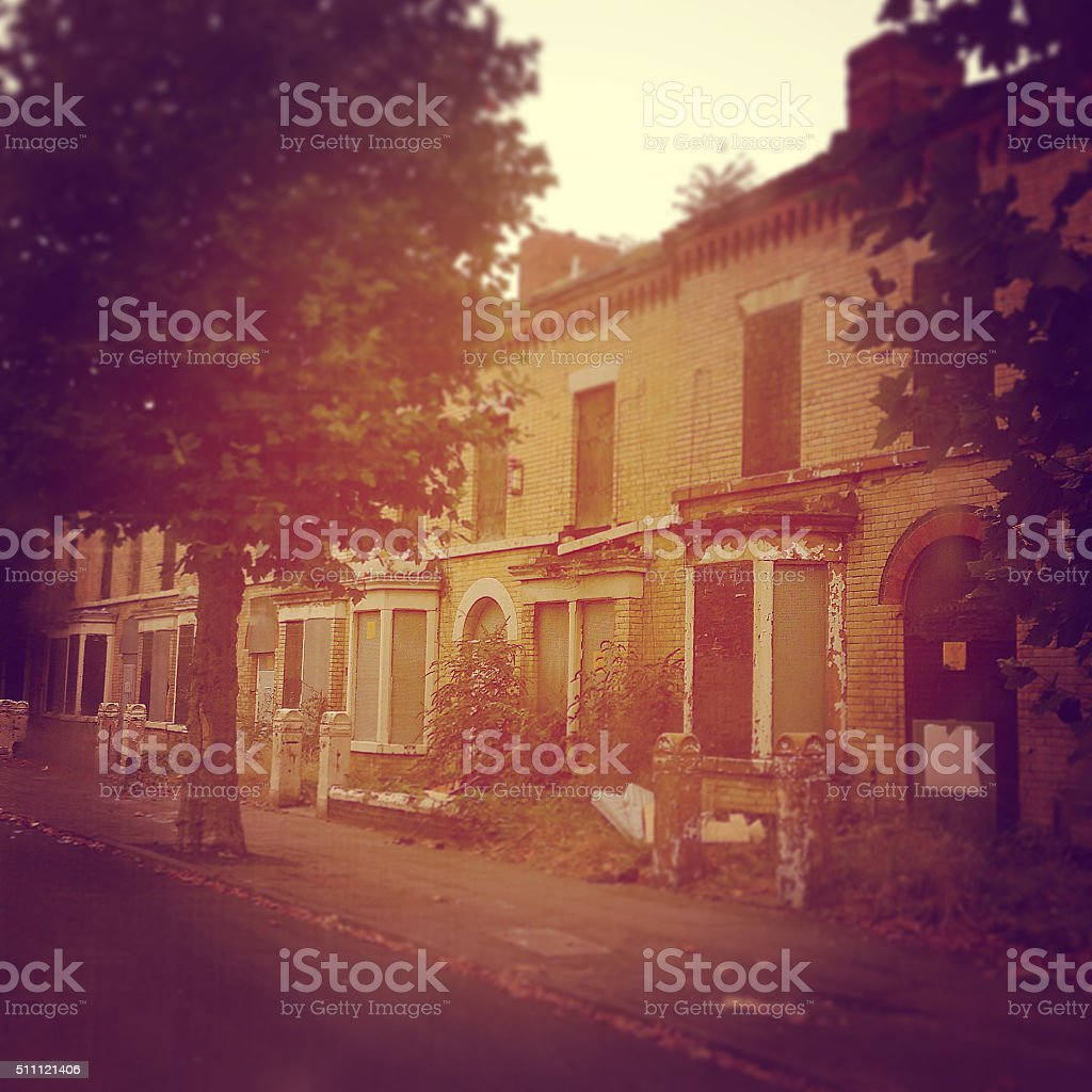 Decaying row of terraced houses stock photo